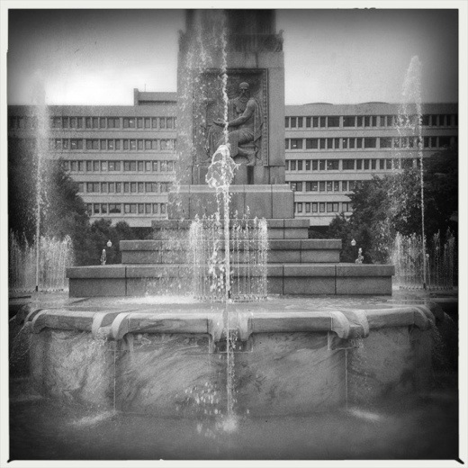Old contrasted with new. Obelisk and fountain with the Minton-Capehart Federal Building.