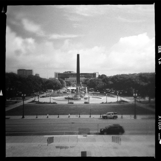 The Obelisk Square and Library aligned with the World War Memorial. Viewing north. Taken with Hipstamatic Americana pack.