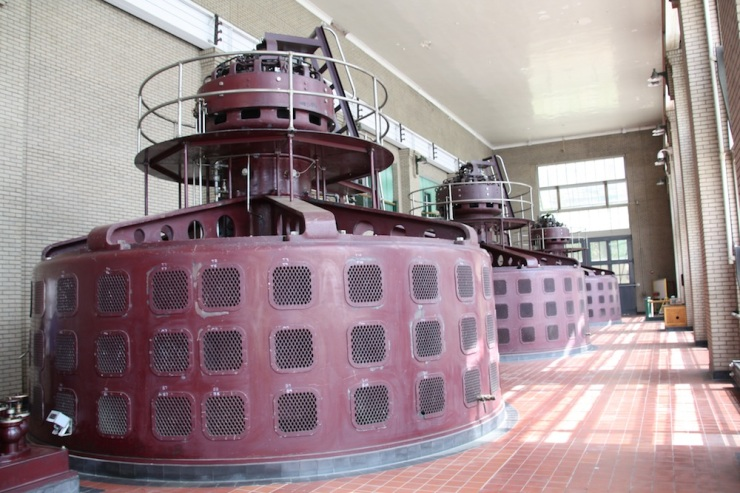 The top parts of the generators, in the main room of the power house.