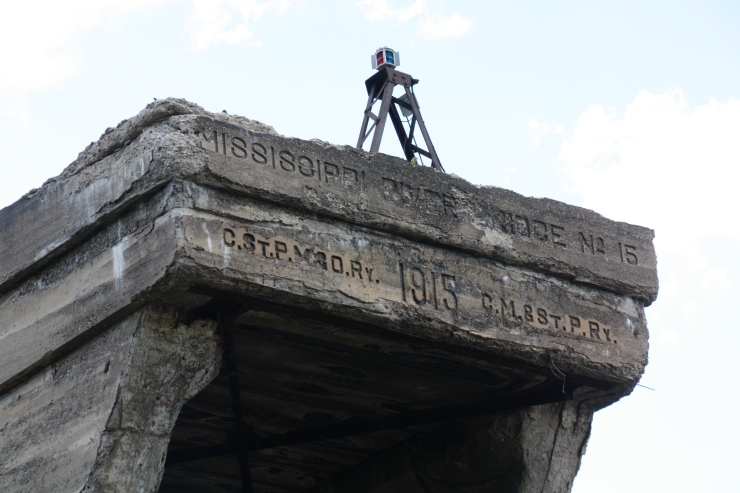 Details inscribed in the top of the concrete counterweight.