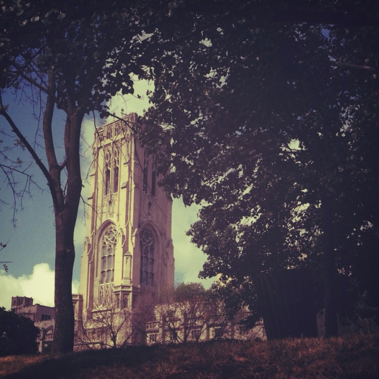 A summer's day. The beautiful Scottish Rite Cathedral hiding within the trees of the World War Memorial Plaza.