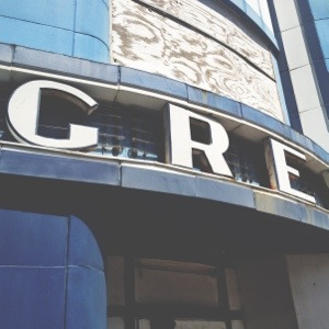"""A detail shot of the beautiful letters that spell """"Greyhound"""" across the entrance of the building."""