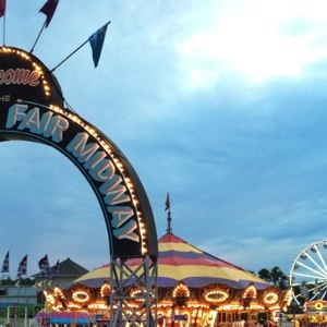 The Indiana State Fair Midway sign, the carousel, and the ferris wheel. Iconic staples of the fair.