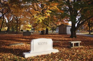 Leaf covered graves at Crown Hill Cemetery