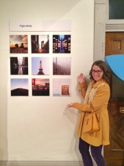 Raina next to one of her two photos in the show.